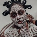 Laolu Senbanjo creating a body painting on the actress Danielle Brooks in his Br...