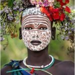 Suri Girl of Ethiopia - the patterns and the strong contrast of white on her ...